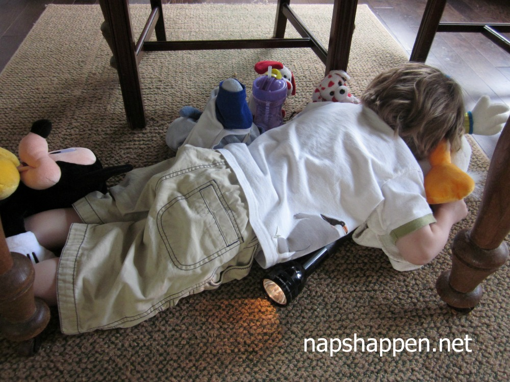 child asleep under table