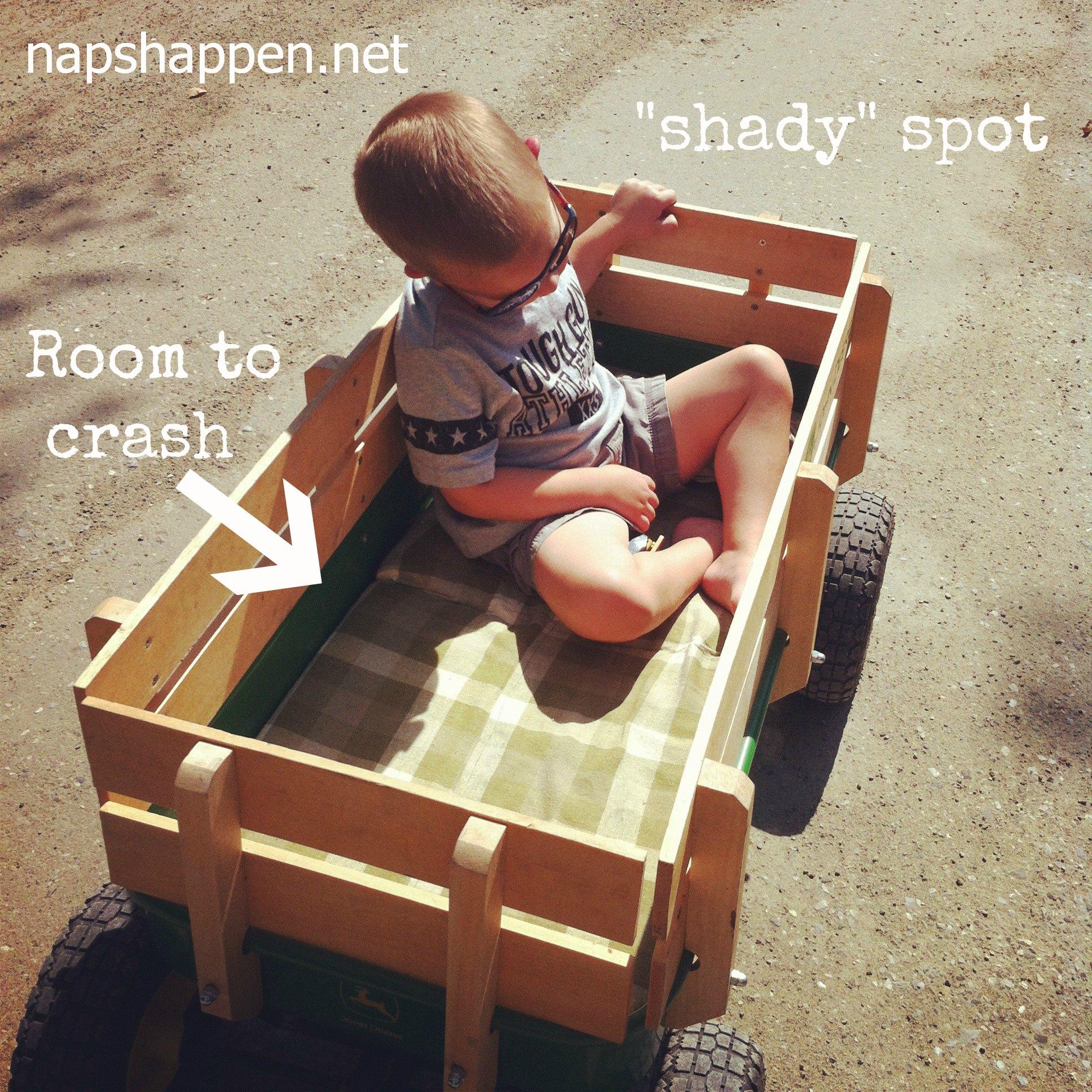 child asleep in wagon