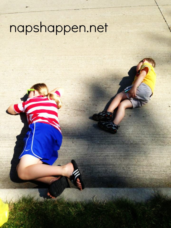 kids asleep on pavement