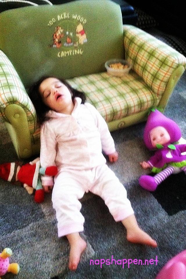 girl asleep with dolls