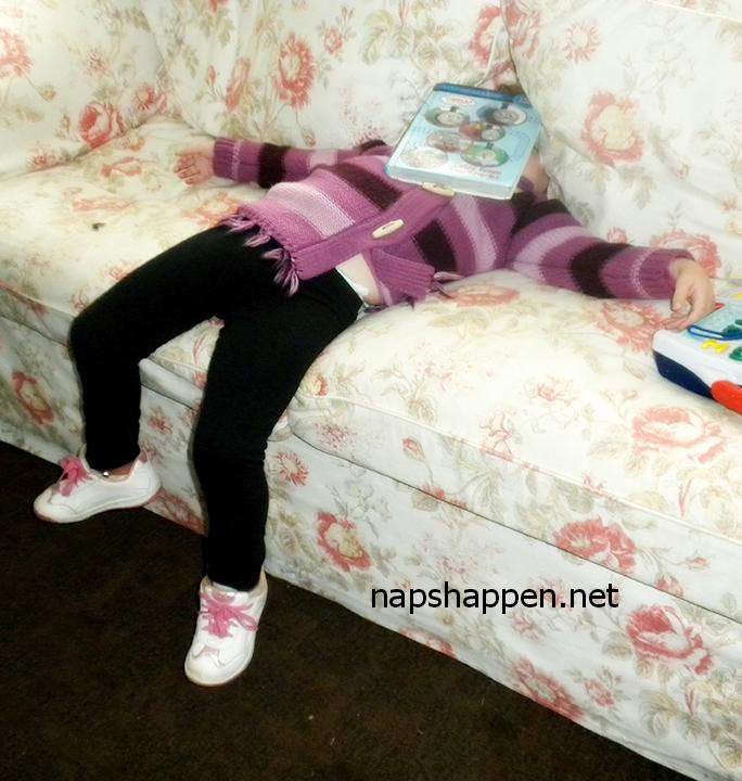 girl asleep in book
